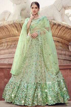 Pista Green Colored Soft Net Heavy Lehenga Choli For Ring Ceremony