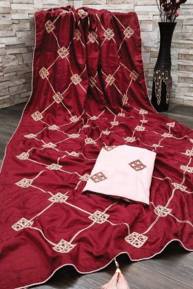 Pretty Looking Maroon Dola Silk Saree With Fancy Gota Patti Work