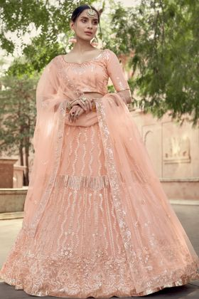 Pretty Looking Peach Color Soft Net Party Wear Lehenga Choli Online Shop