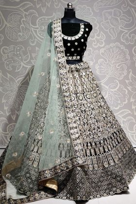 Pure Velvet Embroidered Dark Green Color Heavy Bridal Lehenga At 2021