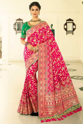 Rani Color Banarasi Silk Saree With Heavy Zari Embroidery Work