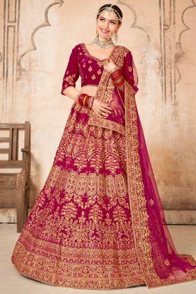 Rani Pink Color Velvet Bridal Lehenga Choli With Hand Work Embroidery
