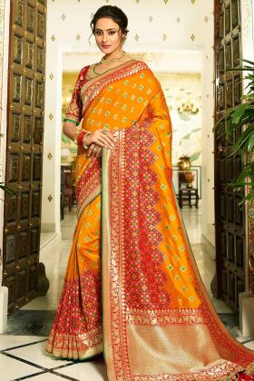 Resham Embroidery Work Banarasi Silk Wedding Saree In Orange Color