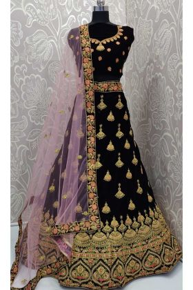 Royal Looks Dark Purple Velvet Stone Work Bridal Lehenga Choli With Net Dupatta