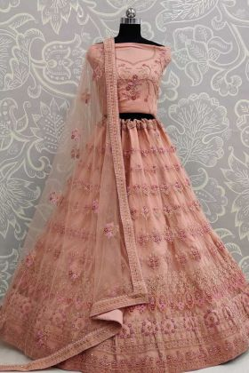 Semi-stitched Net Peach Embroidered Lehenga Choli