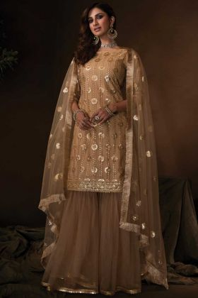 Sequence Work Heavy Design Beige Color Party Wear Net Sharara Suit