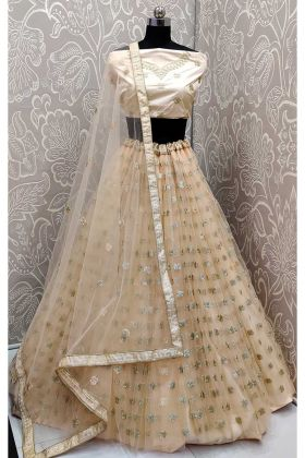 Sequence Work Cream Color Net Designer Lehenga Choli