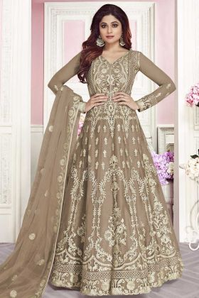 Shamita Shetty Heavy Design Soft Net Wedding Salwar Kameez In Beige Color