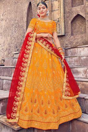 Silk Wedding Lehenga Choli Heavy Zari Embroidery Work In Orange Color