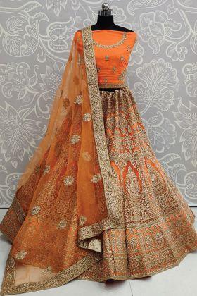 Soft Net Heavy Embroidered Orange Color Bridal Lehenga Choli