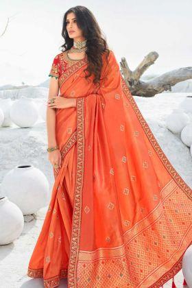 Stone Work Orange Jacquard Silk Festive Wear Saree