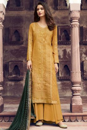 Stone Work Jacquard Silk Palazzo Salwar Kameez In Mustard Yellow Color