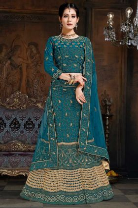 Stone Work Net And Satin Reception Lehenga Choli In Blue Color