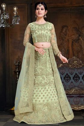 Stone Work Net And Satin Reception Lehenga Choli In Pastel Green Color