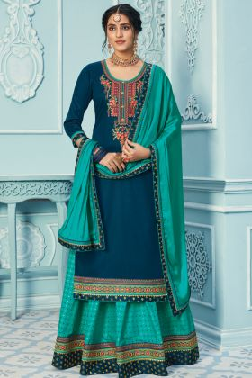 Stylish Designer Teal Blue Heavy Woman Dress In Zam Silk Fabric