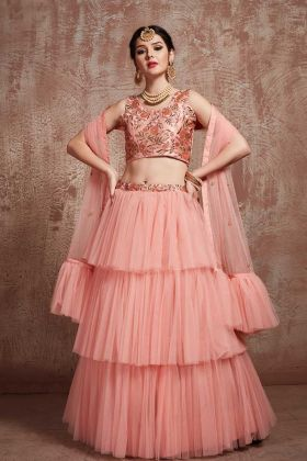Stylish Jari Embroidery Net Layered Lehenga In Peach Color