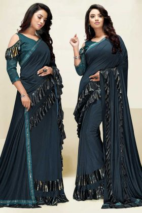 Teal Blue Color Imported Fabric Ruffle Saree With Swarovski Work