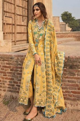 Unqiue Designer Cambric Cotton Muslin Pakistani Salwar Suit In Yellow Color