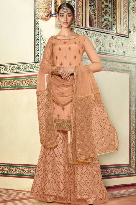 Upcoming Wedding Wear With Peach Net Designer Sharara Suit