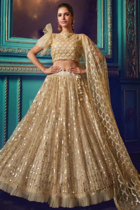 Very Pretty Heavy Designer Net Lehenga Choli In Beige Color