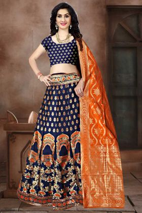 Weaving Work Banarasi Jacquard Silk Lehenga Choli In Navy Blue Color