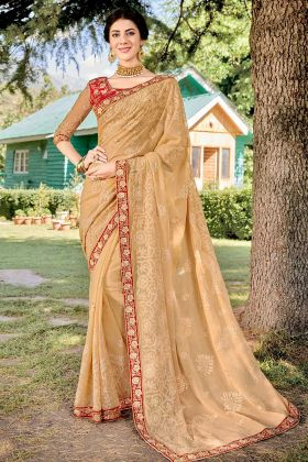 Zari Embroidery Work Georgette Party Wear Saree In Light Beige Color