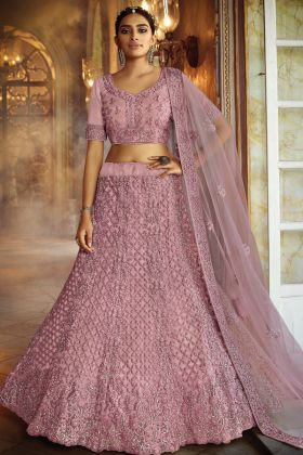 Zarkan Work Pink Color Soft Net Heavy Reception Lehenga Choli Collection